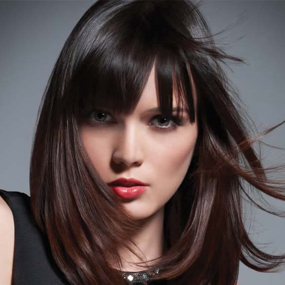Balayage is the highlighting process in which a colorist hand-paints color